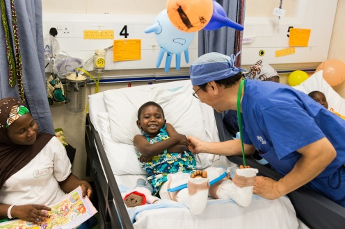 Dr. James Lau, Orthopedic Surgeon, does his rounds with the patients in the wards.