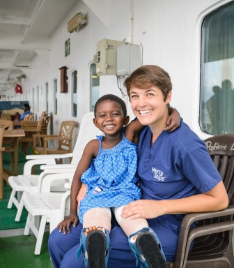 Ward nurse Bettina Krausert with ortho patient Adamou on deck 7