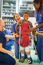 Ortho patient Justine taking her first step few days after surgery