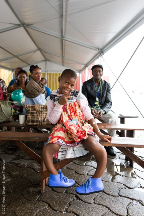 Justine, Orthopedic patient, waiting in the tent during screening.