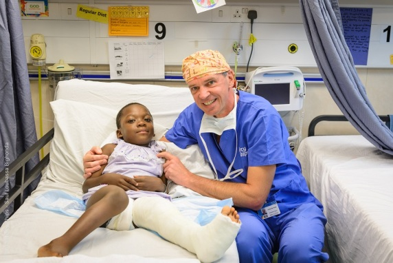 Ortho surgeon Johannes Kolbe with his patient in the ward