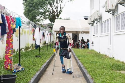 Ulrich walking with crutches at the HOPE Center.